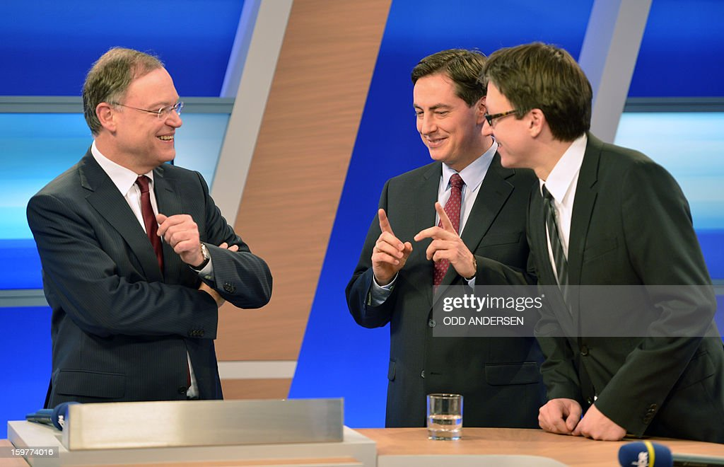 Top candidate of the Social Democrats, SPD, Stephan Weil, State premier of Lower Saxony David McAllister and top candidate of the Free Liberals, FDP, Stefan Birkner talk in a TV studio at the Landtag regional parliament in Hanover on January 20, 2013 on polling day of the local elections in the central German state of Lower Saxony. The vote is largely seen as a test run for Chancellor Angela Merkel, her rivals and would-be heirs, eight months before nationwide polls. German Chancellor Angela Merkel's party was ahead after the first state poll in a general election year, exit polls indicated, but it was unclear whether its coalition would cling to power. AFP PHOTO / ODD ANDERSEN