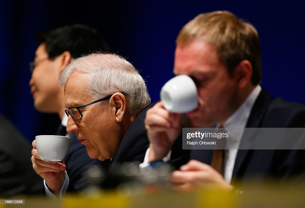 Top candidate Rainer Bruederle (L) of the German Free Democrats (FDP) political party and party member Christian Lindner have a cup of coffee at the FDP federal congress (Bundesparteitag) on May 4, 2013 in Nuremburg, Germany. The FDP is the junior partner in the current German government coalition, though its popularity has faltered in recent years and the party is in danger of not receiving the required minimum of 5% of votes to retain seats in the Bundestag in federal elections scheduled for September.