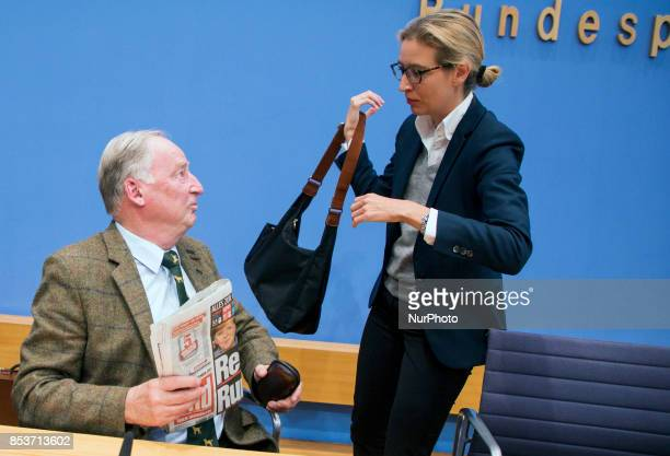 Top candidates of Alternative for Germany Alexander Gauland and Alice Weidel chat at the end of a press conference on the day after the elections at...