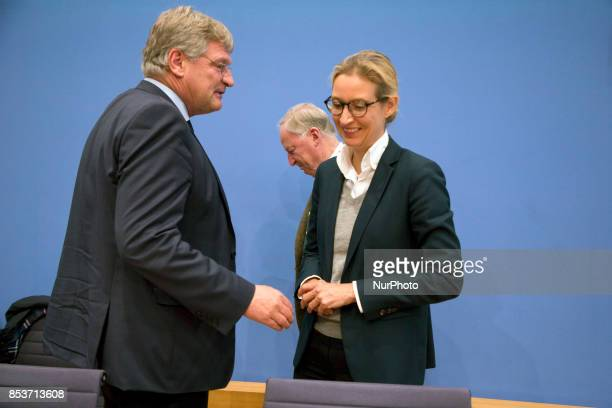 Top candidates of Alternative for Germany Alexander Gauland and Alice Weidel and chaiman Joerg Meuthen leave a press conference on the day after the...