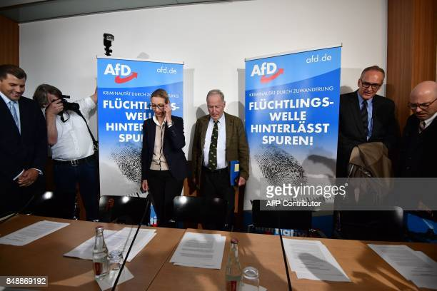 Top candidates of Germany's antiIslam antiimmigration AfD party Alice Weidel and Alexander Gauland arrive to give a press conference about...