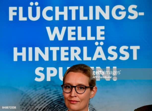 Top candidates of Germany's antiIslam antiimmigration AfD party Alice Weidel and Alexander Gauland give a press conference about immigration and...