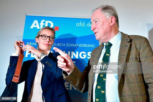 Top candidates of Germany's antiIslam antiimmigration AfD party Alice Weidel and Alexander Gauland leave after a press conference about immigration...