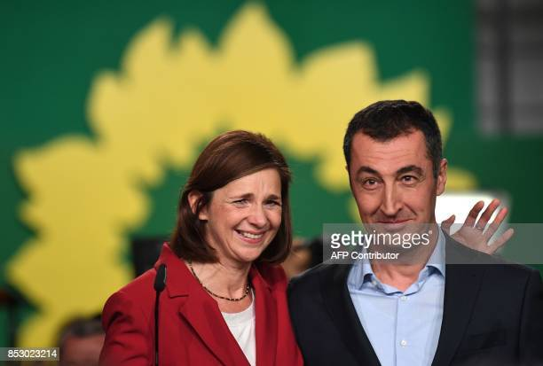 Top candidates of the Green party Cem Ozdemir and Katrin GoeringEckardt speak to supporters after exit poll results were broadcasted on public...
