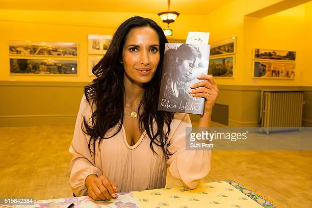 Top Chef host Padma Lakshmi poses with a copy of her new memoir 'Love Loss and What We Ate' at Town Hall Seattle on March 14 2016 in Seattle...