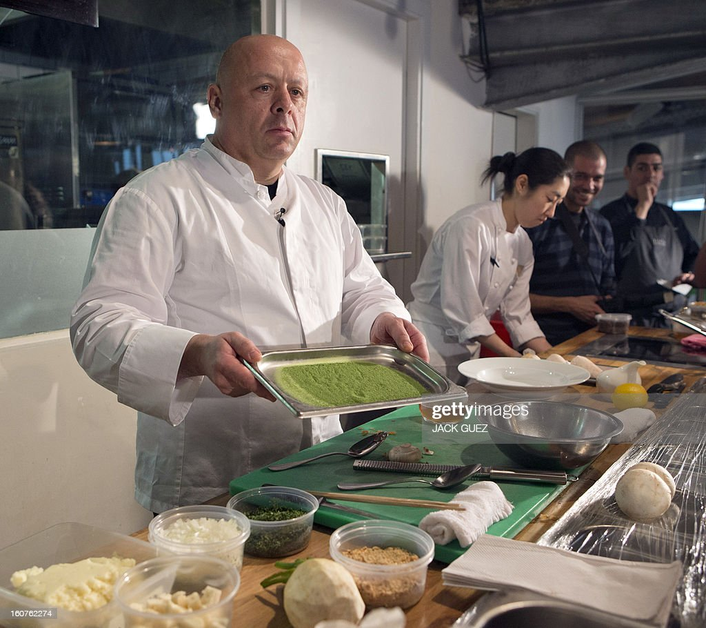Top chef Thierry Marx (L) hosts a molecular gastronomy workshop on February 5, 2013, at the Kitchen Market Restaurant in the Mediterrannean coastal city of Tel Aviv during the event 'So French, so Good' week of French food.