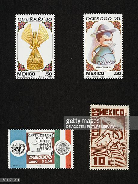 Top Christmas postage stamps depicting the an Angel with a trumpet and Christmas series depicting a Shepherd bottom left postage stamp commemorating...