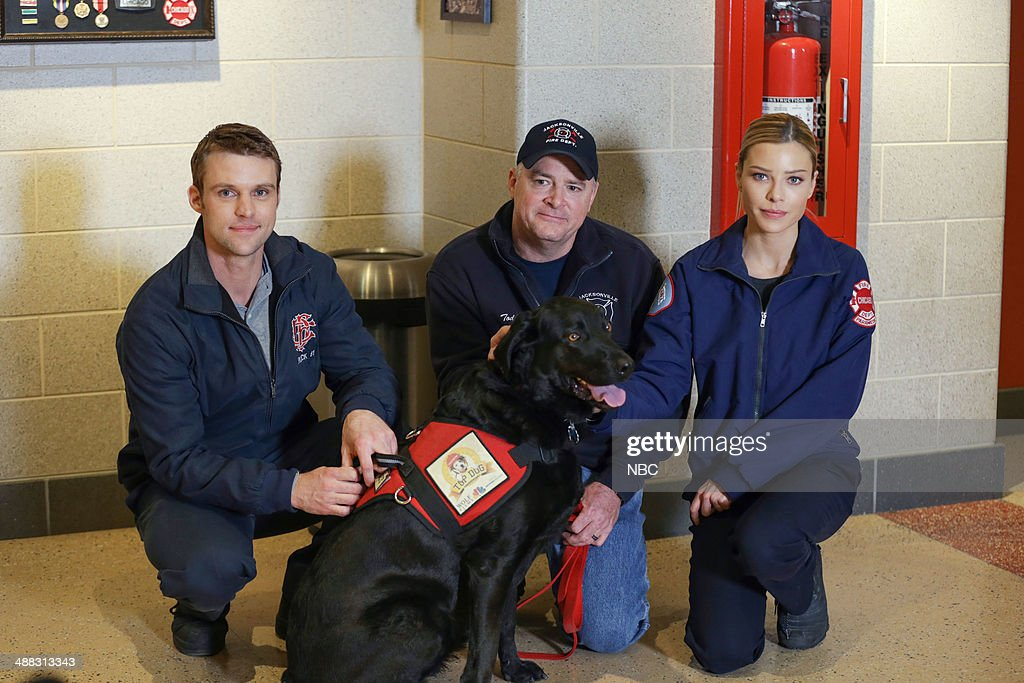 FIRE -- 'Top Dog: Smokey' -- Pictured: (l-r) <a gi-track='captionPersonalityLinkClicked' href=/galleries/search?phrase=Jesse+Spencer&family=editorial&specificpeople=630230 ng-click='$event.stopPropagation()'>Jesse Spencer</a>, Smokey, Jacksonville Fire Lt. Todd Warrick, Lauren German --