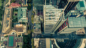 Top down aerial view of skyscrapers in a downtown city district. Metropolis