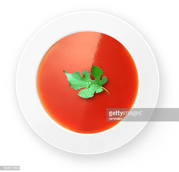Top down photo of a garnished bowl of tomato soup