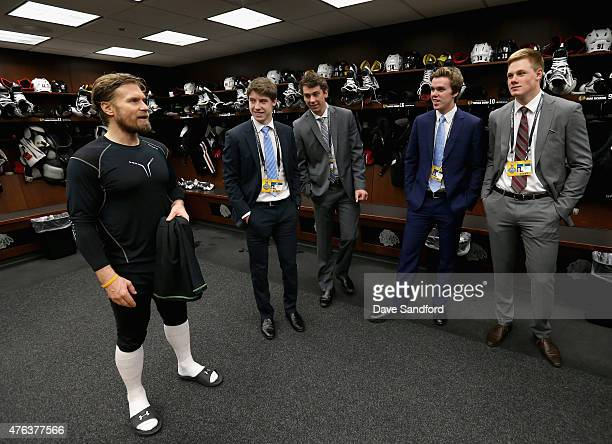 NHL top draft prospects Connor McDavid Dylan Strome Mitchell Marner and Lawson Crouse speak to Kimmo Timonen of the Chicago Blackhawks in the locker...