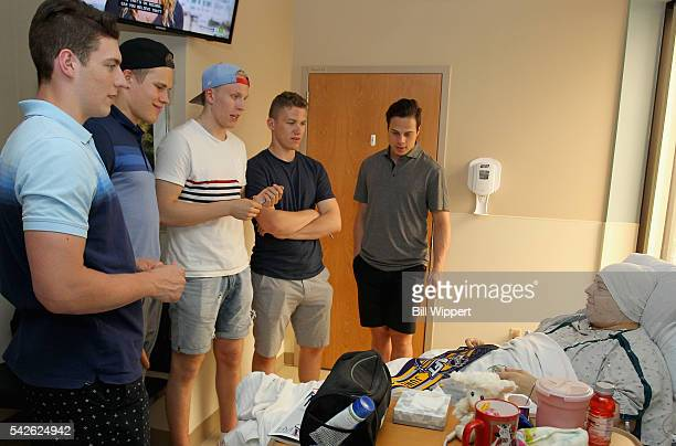 NHL top draft prospects PierreLuc Dubois Jesse Puljujarvi Patrik Laine Matthew Tkachuk and Auston Matthews talk with patient Nicole Tomasulo during a...