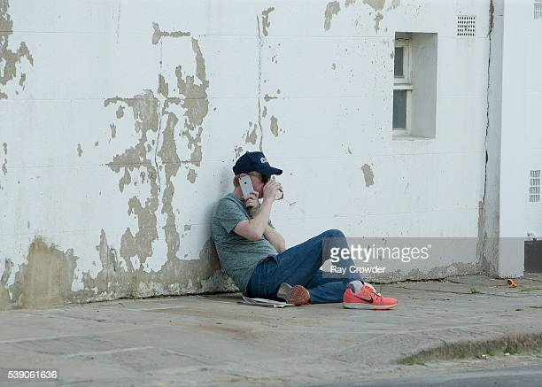 Top Gear presenter Chris Evans seen sipping wine whilst lying against a wall on JUNE 06 2016 in London United Kingdom