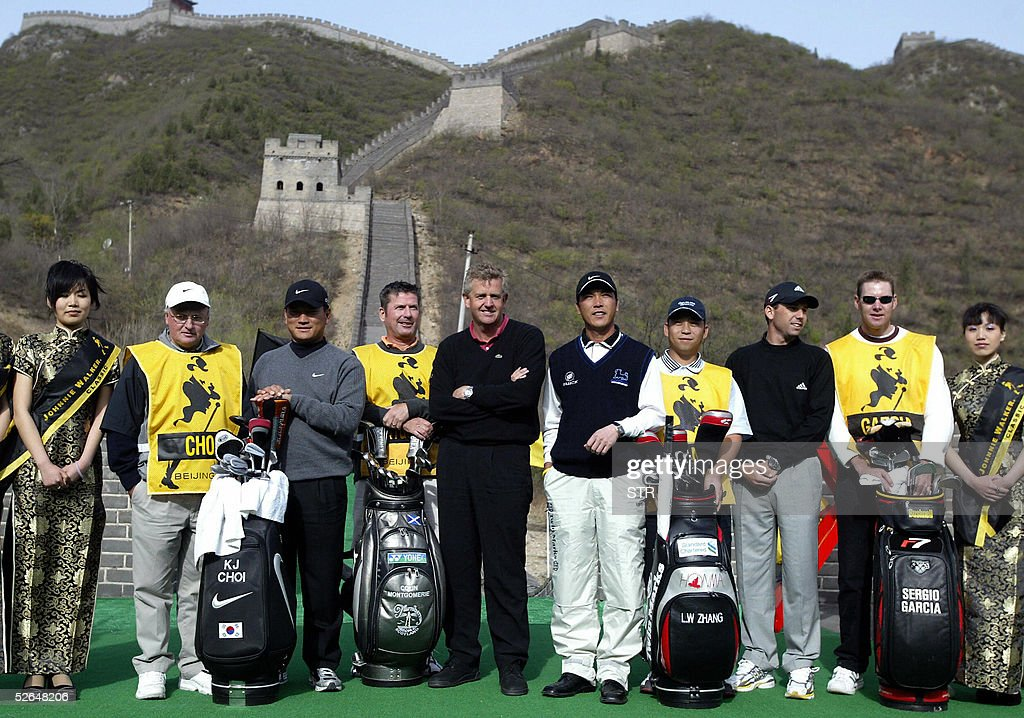 Top golf players South Korea's KJ Choi Scotland's Colin Montgomerie China's Zhang Lianwei and Spain's Sergio Garcia together with their caddies pose...