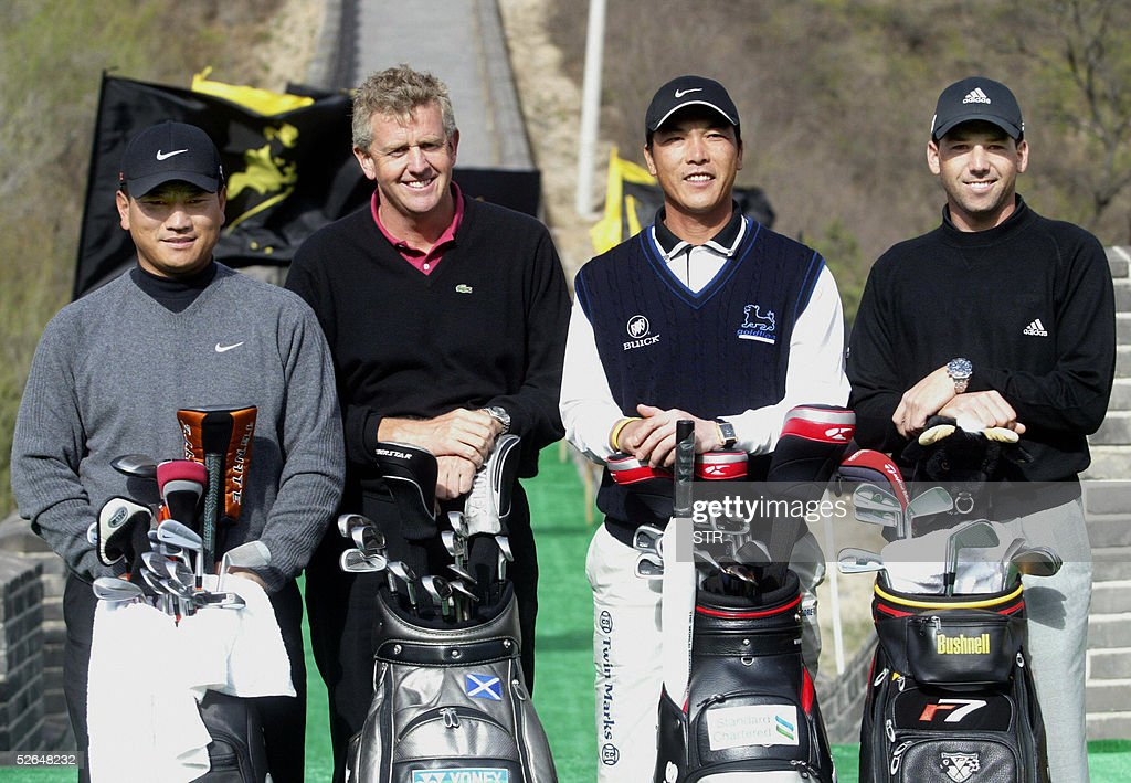Top golf players South Korea's KJ Choi Scotland's Colin Montgomerie China's Zhang Lianwei and Spain's Sergio Garcia pose for a photo on the Great...