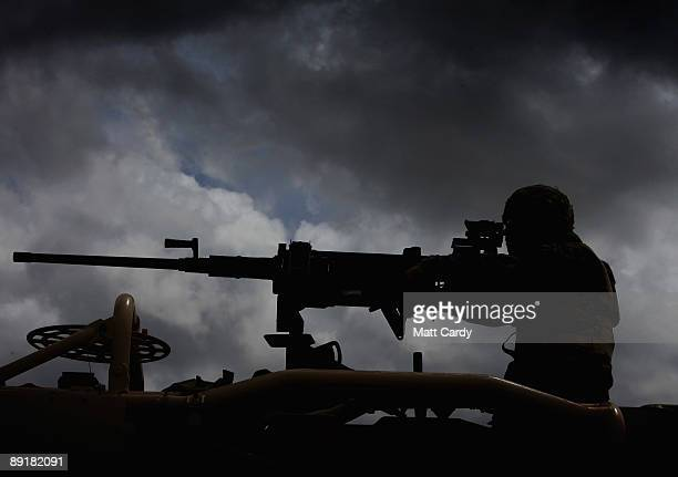 A top gunner looks through the sights of his heavy machine gun on top of a Jackal patrol vehicle as he takes part in a predeployment training...