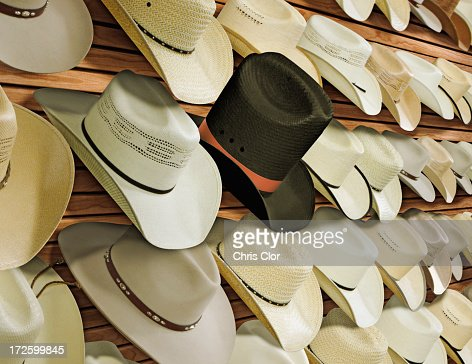 Top hat for sale among cowboy hats : Stock Photo