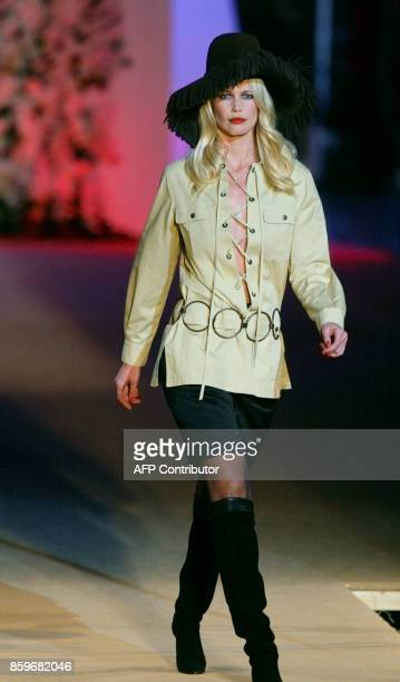 Top model Claudia Schiffer presents a creation for French designer Yves Saint Laurent 22 January 2002 during the retrospective part of Saint...