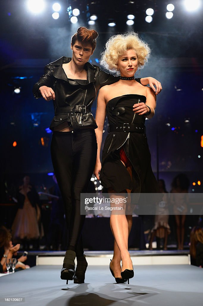 Top model <a gi-track='captionPersonalityLinkClicked' href=/galleries/search?phrase=Coco+Rocha&family=editorial&specificpeople=4172514 ng-click='$event.stopPropagation()'>Coco Rocha</a> and fellow model walk the runway during Jean Paul Gaultier show as part of the Paris Fashion Week Womenswear Spring/Summer 2014 at Le Paradis Latin on September 28, 2013 in Paris, France.