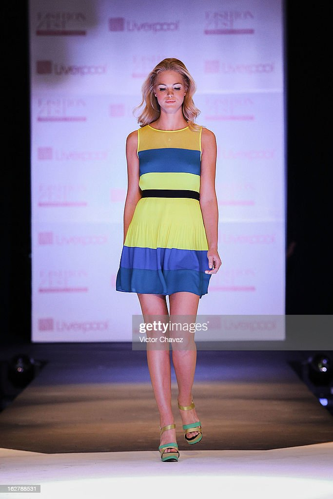 Top model Erin Heatherton walks the runway during the Liverpool Fashion Fest Spring/Summer 2013 fashion show on February 26, 2013 in Mexico City, Mexico.
