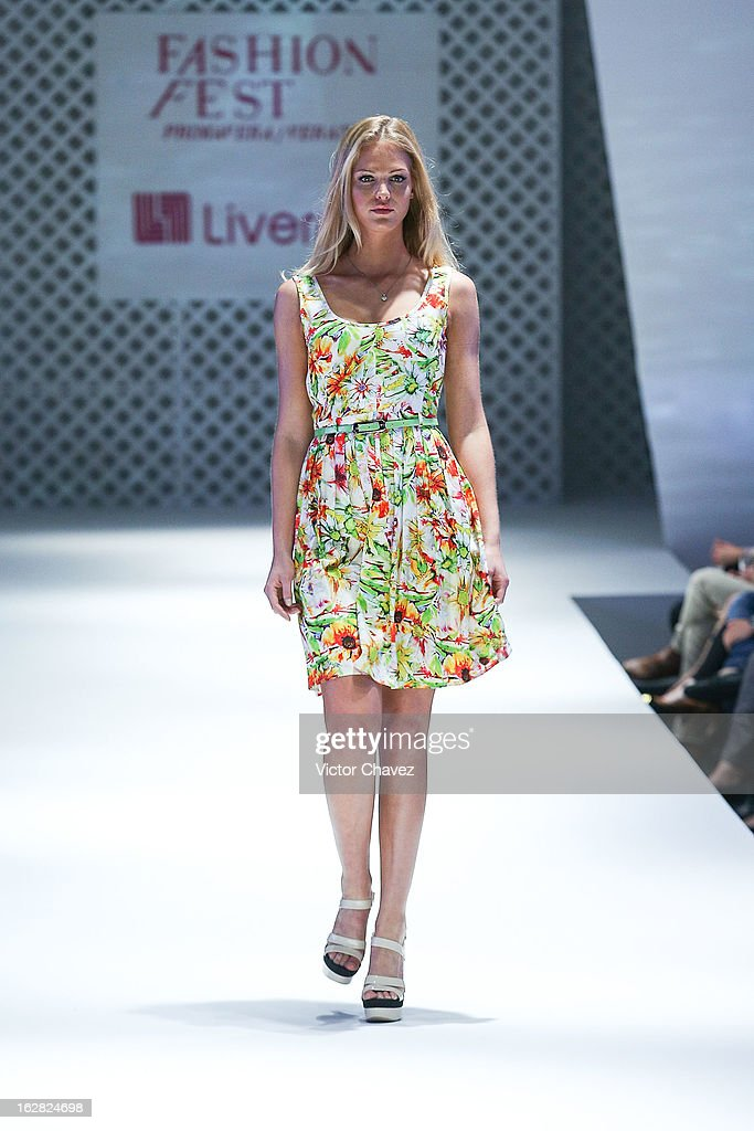 Top model Erin Heatherton walks the runway during the Liverpool Fashion Fest Spring/Summer 2013 fashion show at Liverpool Centro Comercial Angelopolis on February 27, 2013 in Puebla, Mexico.