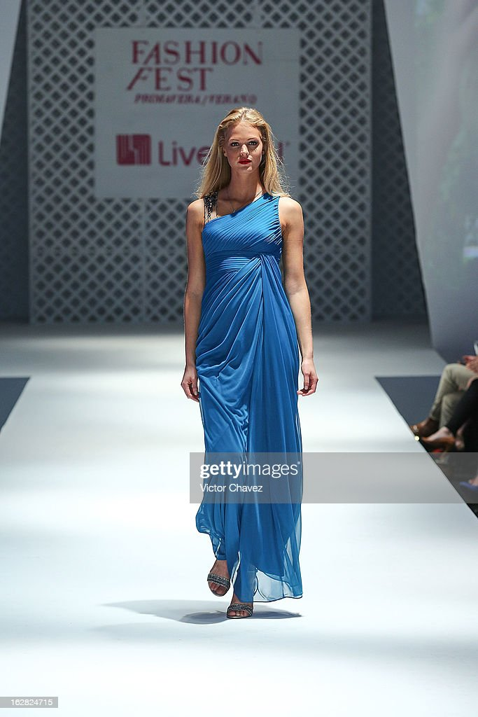 Top model <a gi-track='captionPersonalityLinkClicked' href=/galleries/search?phrase=Erin+Heatherton&family=editorial&specificpeople=5003810 ng-click='$event.stopPropagation()'>Erin Heatherton</a> walks the runway during the Liverpool Fashion Fest Spring/Summer 2013 fashion show at Liverpool Centro Comercial Angelopolis on February 27, 2013 in Puebla, Mexico.
