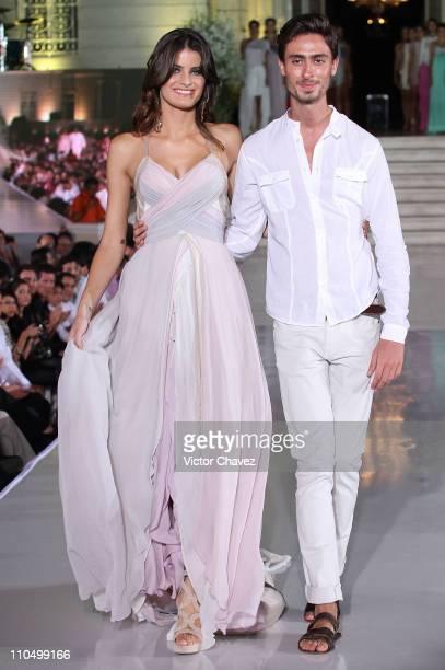 Top model Isabeli Fontana and fashion designer Kris Goyri walk the runway during the Yucatan Moda Nextel 2011 at Quinta Montes Molina on March 19...