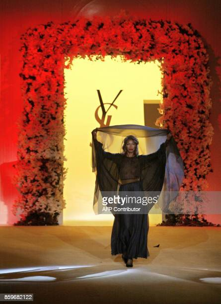 Top model Katoucha presents a creation for French designer Yves Saint Laurent 22 January 2002 during the retrospective part of Saint Laurent's last...