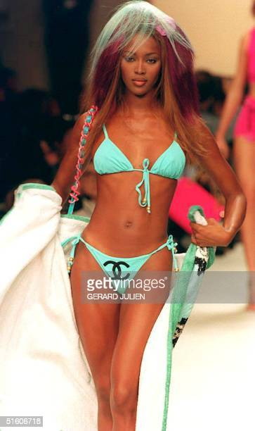 Top model Naomi Campbell presents 14 October 1993 in Paris France a turquoise twopieces bathing suit and a white bathrobe by Karl Lagerfield during...