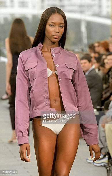 Top model Naomi Campbell presents a brushed cotton jacket over a white bra and matching panties designed by Marc Jacobs for Louis Vuitton's...