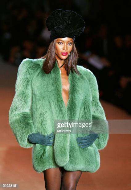 Top model Naomi Campbell presents a creation for French designer Yves Saint Laurent 22 January 2002 during the retrospective part of Saint Laurent's...