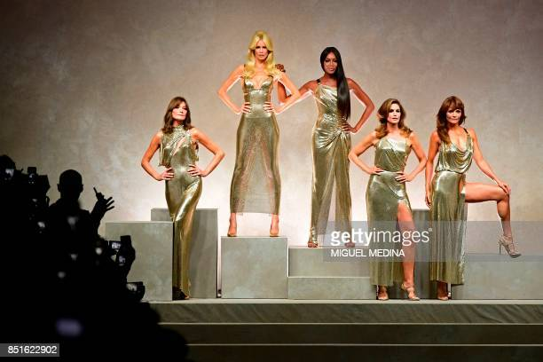Top models Carla Bruni Claudia Schiffer Naomi Campbell Cindy Crawford and Helena Christensen pose at the end of the show for fashion house Versace...