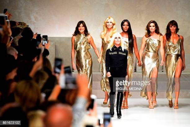 Top models Carla Bruni Claudia Schiffer Naomi Campbell Cindy Crawford and Helena Christensen pose with Italian designer Donatella Versace at the end...