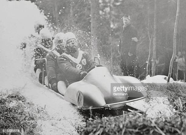 A top notch German four man bobsled team Andreas Ostler Friedrich Kuhn Lorenz Niebrel and Franz Kemser rumbled to an Olympic Gold Medal today by...