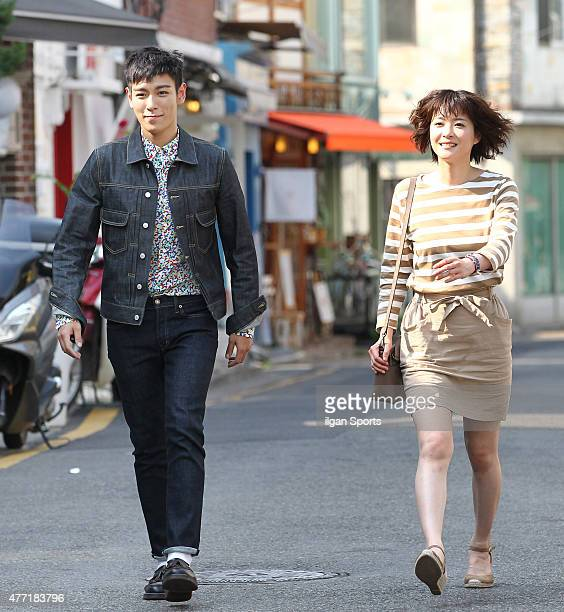 Top of Bigbang and Ueno Juri are seen during drama filiming at Samcheongdong on June 10 2015 in Seoul South Korea
