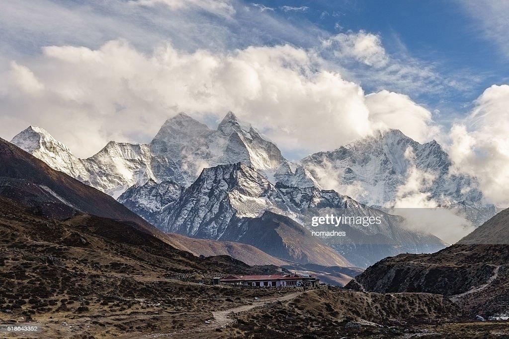 Top of himalayan mountain range with sunrise.