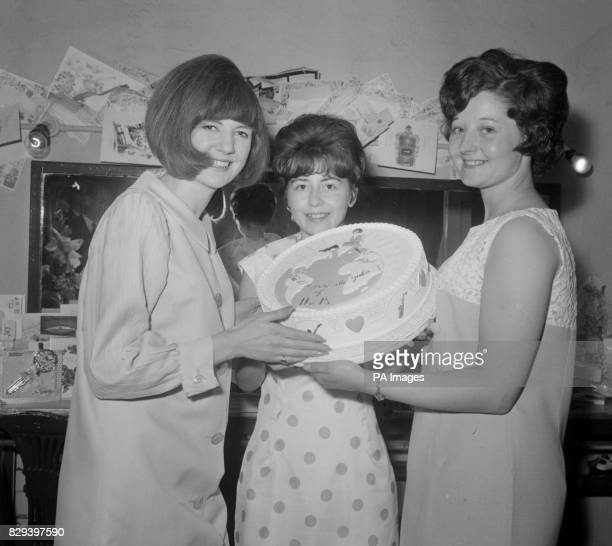Top of the pops star Cilla Black whose 'You're My World' record has gone to the top of the hit parade this week pictured when she received a special...