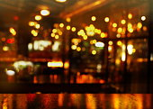 top of wood table and party light of bokeh in bar or club at night background