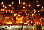 top of wood table with blur light orange lamp of bar club or pub for party in the dark night backgroubd