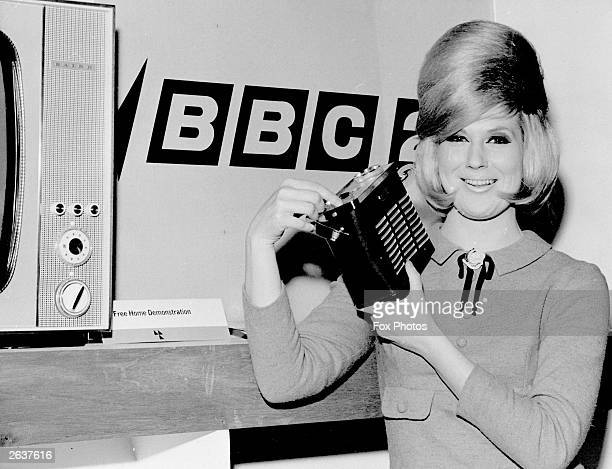Top pop singer Dusty Springfield at the Ideal Home Exhibition Olympia London where she was presented with a Baird transistor radio by the Radio...