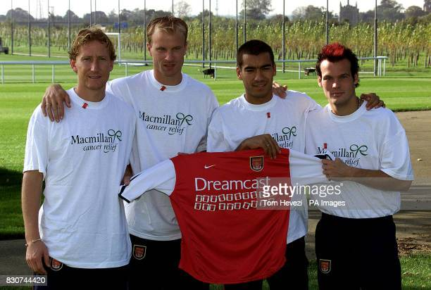 Top Premiership players Dennis Bergkamp Giovani van Bronckhorst Freddie Ljungberg and Ray Palour pinned new colours to their chests to kick off the...