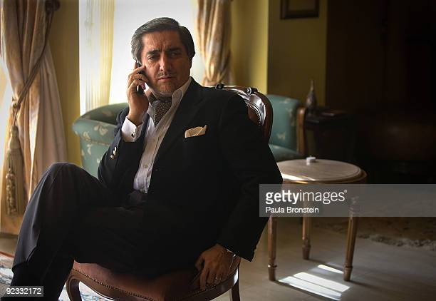 Top presidential challenger Abdullah Abdullah talks on the phone inside his Kabul home October 25 2009 in Kabul Afghanistan Abdullah Abdullah and...