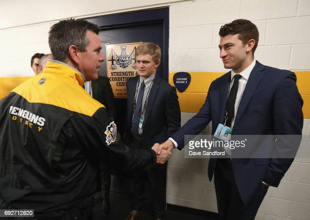 Top prospect Gabriel Vilardi shakes hands with head coach Mike Sullivan of the Pittsburgh Penguins as Casey Mittelstadt looks on during the media...
