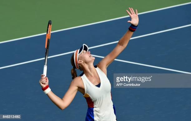 TOPSHOT Top seed Kristina Mladenovic of France serves against Jena Fett of Croatia during their first round match of the Japan Women's Open tennis...
