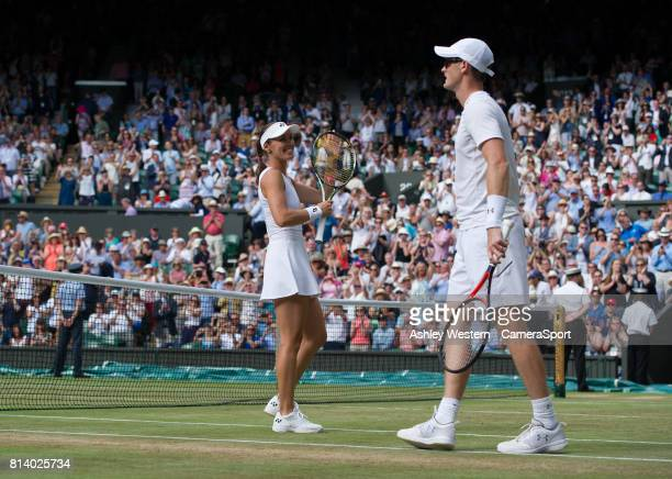 Top seeds Jamie Murray with partner Martina Hingis celebrate their victory against Ken Skupski and Jocelyn Rae at Wimbledon on July 13 2017 in London...