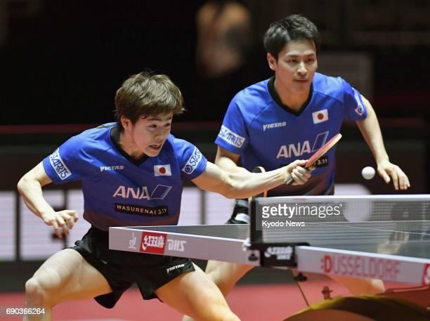 Top seeds Masataka Morizono and Yuya Oshima of Japan play against Portugal's Marcos Freitas and Croatia's Andrej Gacina in the men's doubles first...