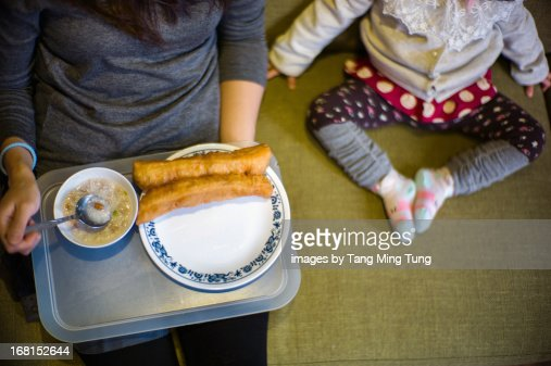 Top shot of mom & toddler having Chinese breakfast : Stock Photo