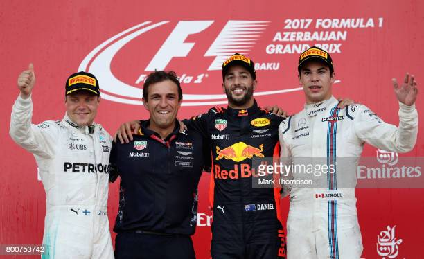 Top three finishers Daniel Ricciardo of Australia and Red Bull Racing Valtteri Bottas of Finland and Mercedes GP and Lance Stroll of Canada and...