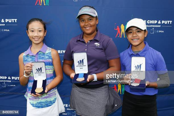 Top three finishers in the girls 1213 years division Kasey Maralack Meghan Paracuelles and Jordan Chan pose for a photo after the Drive Chip and Putt...
