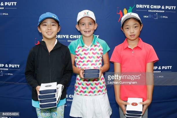 Top three finishers in the overall girls 79 years division Asterisk Talley Abigail Lin and Angela Zhang pose for a photo after the Drive Chip and...